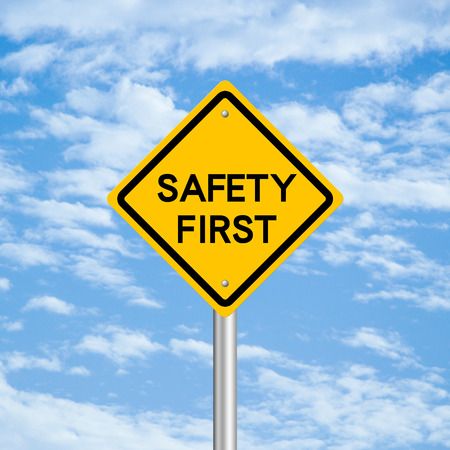 safety: Safety first road sign with blue sky background.