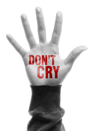 negatively: Hand with Do Not Cry text is isolated on white background. Stock Photo
