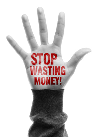 Hand with Stop Wasting Money text is isolated on white background. photo