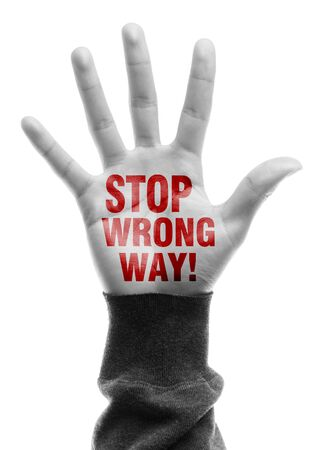 wrong way: Hand with Stop Wrong Way text is isolated on white background.