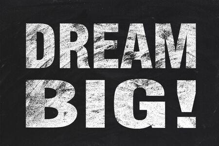 Dream big text is written by white chalk on blackboard. photo