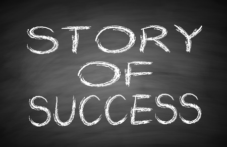 Story of success text is written by white chalk on blackboard. photo