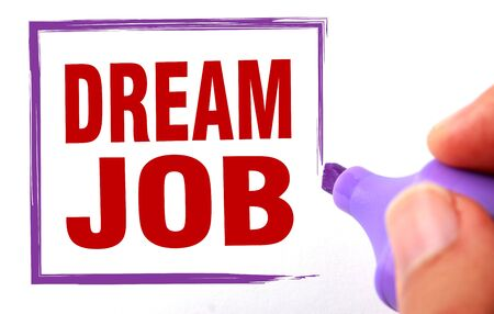 Dream job text is signed by marker on white paper. photo