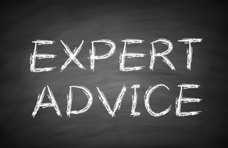 supportive: Expert advice text is written by white chalk on blackboard. Stock Photo