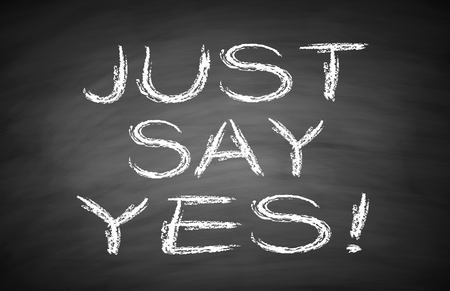 Just say yes text is written by white chalk on blackboard. photo