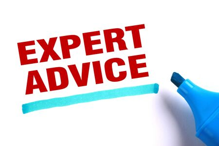 Expert advice text and blue line with blue marker aside is on white paper. photo