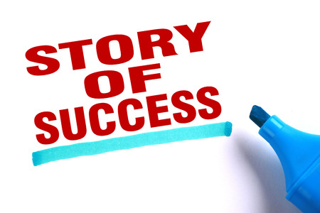 Story of success text and blue line with blue marker aside is on white paper. photo