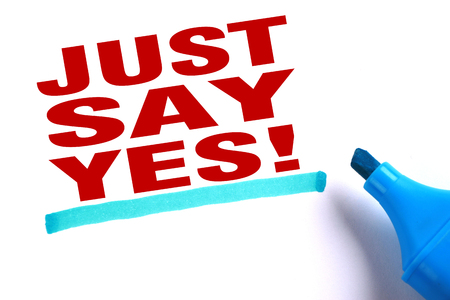 Just say yes text and blue line with blue marker aside is on white paper. photo
