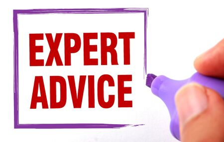 supportive: Expert advice text is signed by marker on white paper. Stock Photo