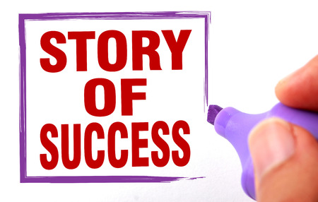 attain: Story of success text is signed by marker on white paper.