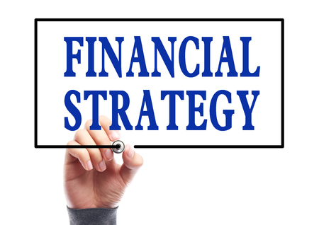 Businessman is writing Financial strategy concept on transparent white board. photo