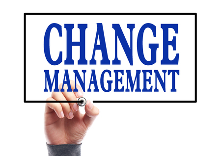 Businessman is writing Change management concept on transparent white board. photo