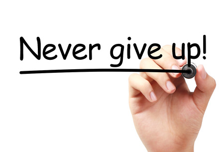 failed attempt: Never give up text is written on transparent white board by hand with marker isolated. Stock Photo