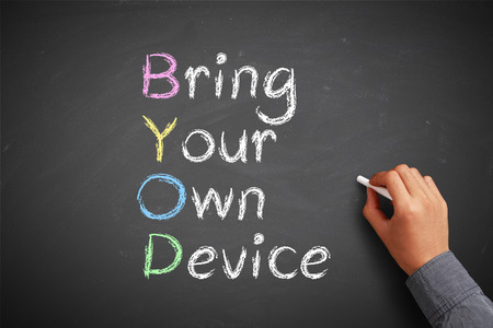 bring: Hand with chalk is drawing Bring your own device concept on the chalkboard.