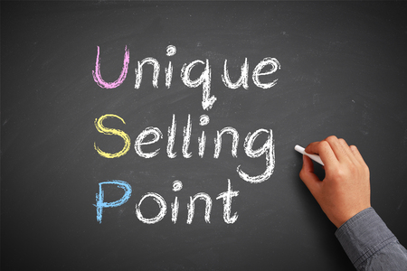 unique selling proposition: Hand with chalk is drawing USP concept on the chalkboard. Stock Photo