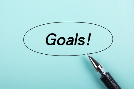 aside: Goals text is on blue paper with black ball-point pen aside.
