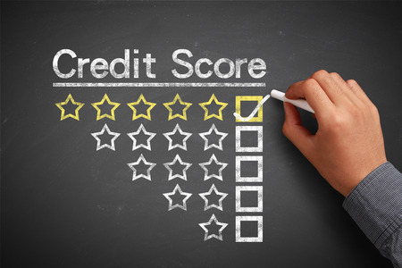 credit report: Hand with chalk is drawing Credit score concept on the chalkboard.