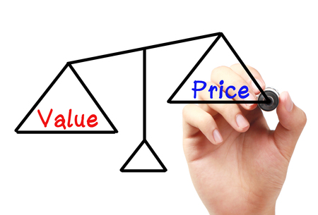 board marker: Hand with marker is drawing Value and price balance scale on the transparent white board.