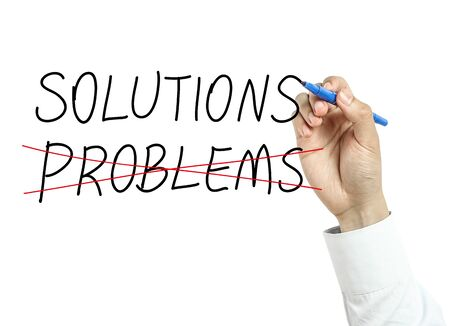 new business problems: Businessman is drawing solutions concept with blue marker on transparent board isolated on white background.