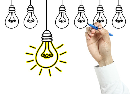 new business problems: Businessman is drawing light bulbs with blue marker on transparent board isolated on white background.