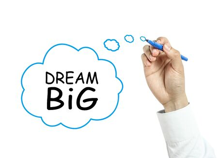 Businessman is drawing dream big concept with blue marker on transparent board isolated on white background. photo