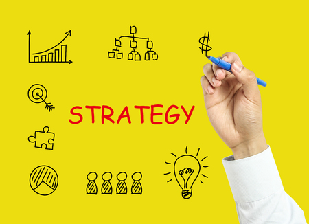 board marker: Businessman is drawing strategy concept with marker on transparent board with yellow background. Stock Photo