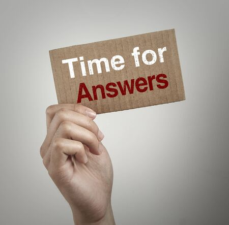 inquiring: Hand with brown card is showing Time for answers with gray background.