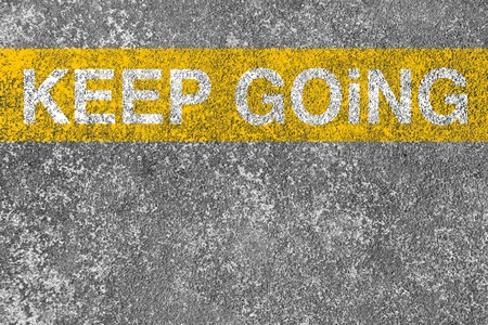 yellow line: Keep going yellow line is on the asphalt road.