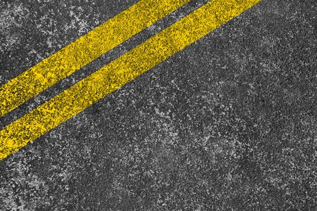 Yellow lines is painted on the asphalt road. photo