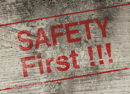 hazardous area sign: Safety first concept text is painted on old fashion wall. Stock Photo