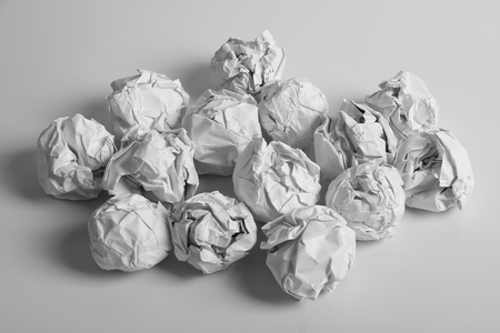 wastepaper basket: White paper balls are on the white background. Stock Photo