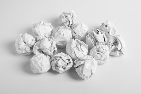 White paper balls are on the white background. photo
