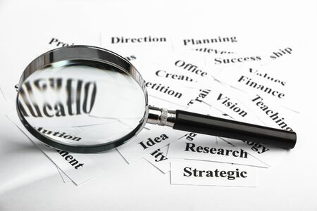 buzz word: Magnifying glass and lot of other business concept words paper is showing the concept of business vision.