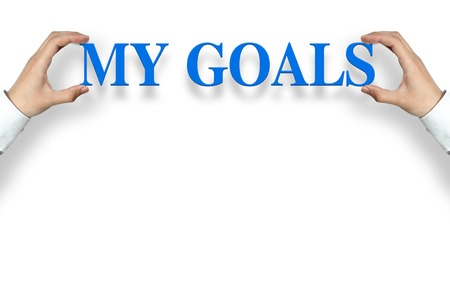 Businessman is holding the My Goals text against the white background with copy space. Stock Photo