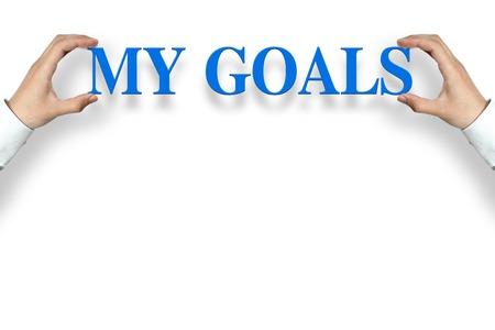 metas: El hombre de negocios está sosteniendo el texto Mis Metas contra el fondo blanco, con copia espacio. Foto de archivo