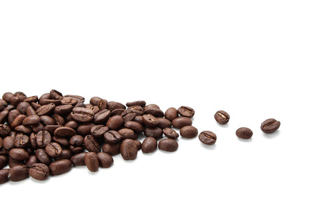 coffee harvest: Some coffee beans is isolated on white background. Stock Photo