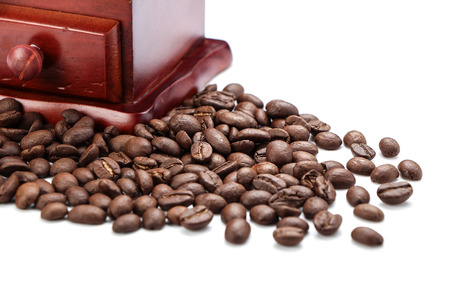 coffe beans: Closeup of coffee bean and coffee bean grinder isolated on white background.