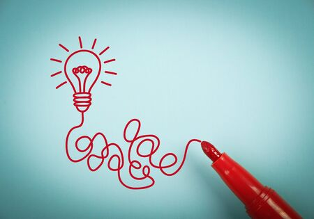 aside: Idea bulb is on blue paper with a red marker aside.