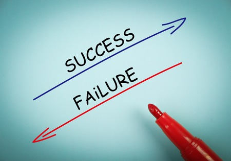 aside: Success and failure concept is on blue paper with a red marker aside.