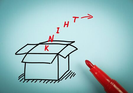 aside: Think outside the box concept is on blue paper with a red marker aside. Stock Photo