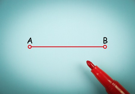 shortest: Point a to point b concept is on blue paper with a red marker aside.