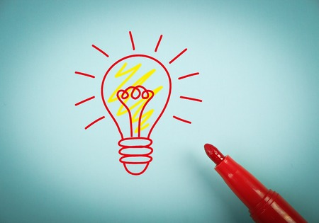 aside: Big idea concept is on blue paper with a red marker aside. Stock Photo