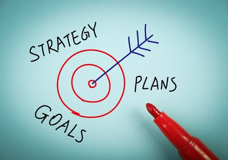 aside: Strategy concept is on blue paper with a red marker aside.