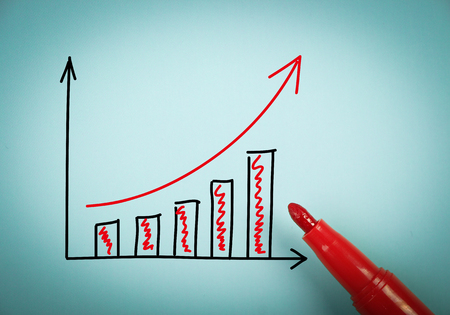 aside: Growth graph is on blue paper with a red marker aside.