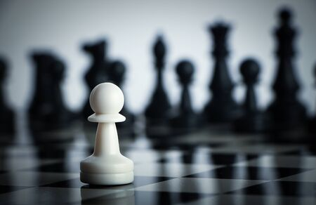 two minds: One chess is staying against full army of chess pieces. Stock Photo