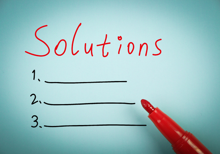 aside: Solutions concept is on blue paper with a red marker aside.
