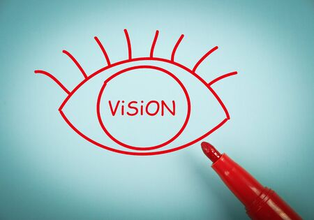 aside: Vision concept is on blue paper with a red marker aside. Stock Photo