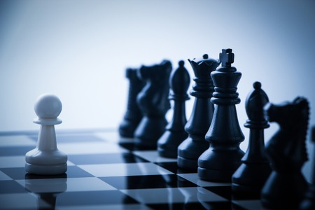 staying: One pawn is staying against a lot of chess pieces.