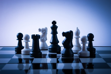 Chess pieces on board with gradually varied background.