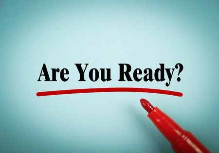 Are You Ready text is written on blue paper with a red marker aside.